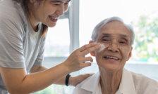 happy old couple playing a bingo