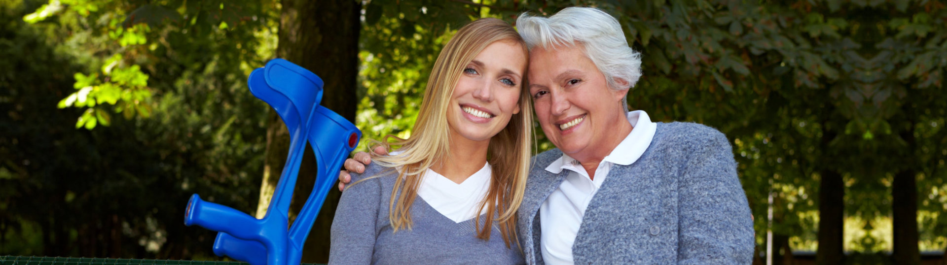 old woman with her caregiver smiling