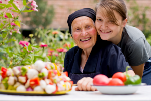 lady and elder woman smiling